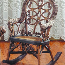 Yesteryear Wicker - Victorian Wicker Childs Rocking Chair - VCHR-C - Shop for Childrens Rocking Chairs from Hayneedle.com! The Victorian Wicker Child Size Rocking Chair features a charming display of loops swirls twists and turns all in beautiful wicker. This rocking chair is made of high quality Indonesian wicker and sized for a child. The rounded back and softly curved arms give a calm and gentle feeling to any setting. This child's wicker rocker is available in your choice of finishes. Since this rocker features all natural wicker it is appropriate for use on a covered porch or indoors.