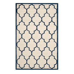 Safavieh - Annette Hand Tufted Rug, Ivory / Navy 3' X 5' - Construction Method: Hand Tufted. Country of Origin: India. Care Instructions: Vacuum Regularly To Prevent Dust And Crumbs From Settling Into The Roots Of The Fibers. Avoid Direct And Continuous Exposure To Sunlight. Use Rug Protectors Under The Legs Of Heavy Furniture To Avoid Flattening Piles. Do Not Pull Loose Ends; Clip Them With Scissors To Remove. Turn Carpet Occasionally To Equalize Wear. Remove Spills Immediately. Bring classic style to your bedroom, living room, or home office with a richly-dimensional Safavieh Cambridge Rug. Artfully hand-tufted, these plush wool area rugs are crafted with plush and loop textures to highlight timeless motifs updated for today's homes in fashion colors.