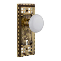 Nostalgic Warehouse - Nostalgic Craftsman Plate with White Porcelain Knob and Keyhole, Antique Brass - Inspired by the American Arts & Crafts movement of the early 1900s, the rugged design and hand-hammered details of the Craftsman Long Plate in antique brass emphasizes handwork over mass production. Add a traditional touch with our pure White Porcelain Knob for a simple, yet vintage, look. All Nostalgic Warehouse knobs are mounted on a solid (not plated) forged brass base for durability and beauty.