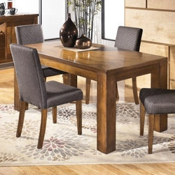 """Ashley Haulani Dining Room Collection - The inviting Metro Modern design of the """"Haulani"""" Dining Collection features a rich walnut veneer coated in a warm natural color finish that beautifully enhances the thick table leg design along with the gray and brown textured upholstered chairs creating a relaxing collection perfect for any dining area."""