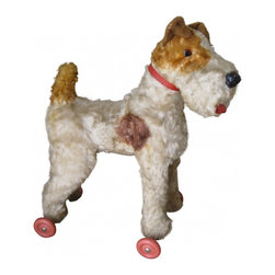 Stuffed Dog on Wheels - He has short fur, glass eyes, vinyl tongue, and his nose is still intact but a bit scuffed. Good vintage condition otherwise. His fur is in true wire hair style. He stands in such a classic terrier pose  which makes him wonderful as a display in a vignette or for photo prop. You don't see many pups like this...truly one of a kind!