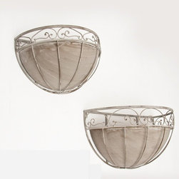 Dover Wall Planter (Set of 2) - Dress up any wall with this gorgeous pair of planters. The Dover Wall Planters have a rustic, weathered look that brings vintage and shabby chic design into the great outdoors. The planters have a lovely oval scroll pattern around their tops, making a lovely counterpoint for the straight lines that travel downward along the frame. The tapered shape enhances their style. Antiqued metal liners are included with the planters, so they arrive ready to be filled and mounted. The set features two planters: a Large 21-inch by 10-3/4-inch by 11-1/2-inch piece and a Small 17-inch by 8-3/4-inch by 9-3/4-inch piece.