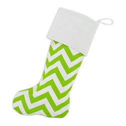 "Chooty & Co. - Chartreuse and White Chevron Christmas Stocking with Optional Personalization - - Shop for Holiday Ornaments and Decor from Hayneedle.com! Lime green might not be a traditional winter color but we don't think Santa will mind! The fun Chooty and Co. Zig-Zag Chartreuse with Velvet Cuff Lined Christmas Stocking is one incredibly colorful keepsake made from high-quality materials that can more than handle the weight of all those gifts! Add up to nine characters in silver thread to make this stocking more personal. About Chooty & Co.A lifelong dream of running a textile manufacturing business came to life in 2009 for Connie Garrett of Chooty & Co. This achievement was kicked off in September of '09 with the purchase of Blanket Barons well known for their imported ""soft as mink"" baby blankets and equally alluring adult coverlets. Chooty's busy manufacturing facility located in Council Bluffs Iowa utilizes a talented team to offer the blankets in many new fashion-forward patterns and solids. They've also added hundreds of Made in the USA textile products including accent pillows table linens shower curtains duvet sets window curtains and pet beds. Chooty & Co. operates on one simple principle: ""What is best for our customer is also best for our company."""
