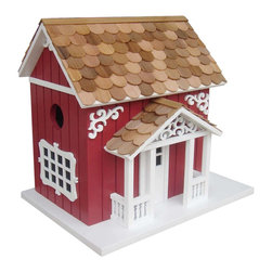 "Home Bazaar Inc. - Swedish Cottage Birdhouse - This classic Swedish Cottage birdhouse has all the details that one might see in the Nordic countryside. A red clapboard exterior, intricate scrollwork detail and charming window details highlight this quaint design. This piece comes equipped with a mounting bracket and is fully decorated on the backs. There are two side by side nest boxes, with an inner divider. Constructed of exterior grade ply-board and topped with western red cedar shingles, the Swedish Cottage has a removable back wall, drainage, ventilation and 1.25"" openings to allow wrens, finches, chickadees, nuthatches and titmice to nest. Intended for outdoor use."