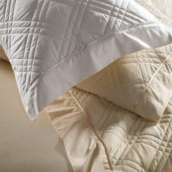 Frontgate - DreamFit Tencel Quilted Sheet Set - Bacteria- and allergen-resistant. Resistant to mold and mildew. Regulates temperature to keep you comfortable all year long. Moisture wicking to help reduce night sweats. Patented strap design with high-performance elastic guarantees your fitted sheet will stay put even with the addition of feather beds, mattress toppers, or foam. With our DreamFit Tencel Quilted Sheet Ensemble, you'll sleep in optimal comfort with temperature-regulating, eco-friendly Tencel, which provides silky softness and hypoallergenic benefits. Tencel is a fully biodegradable, wrinkle-resistant fabric made from environmentally sustainable trees. Set includes a quilted top sheet, a fitted sheet, and two reversible pillowcases, all with Tencel. . . . . . Tencel outer fabric with polyester batting. All pieces feature a breathable 300 thread count. One-year limited manufacturer's warranty. Machine wash on gentle cycle in cold water with no liquid fabric softener; tumble dry on normal heat. Made in the USA of imported materials.