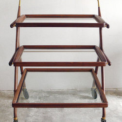 Midcentury Modern Bar/Serving Cart by Green Zebre Home - The best places to look for great midcentury bar carts are at flea markets or online through vintage and antique sites. This chic, midcentury bar cart is a fabulous option for storing your barware and quality liquor.