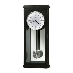Howard Miller 625-440 Alvarez 82nd Anniversary Wall Clock - 10.75-in. Wide - Simple and stately the Howard Miller 625-440 Alvarez 82nd Anniversary Wall Clock - 10.75-in. Wide naturally holds a spot of distinction in your hallway dining room or foyer. Its secret is rich simplicity which comes from a smooth black satin finish simple wooden frame and nickel details. A black satin wooden stick suspends the spun nickel pendulum from the movement where it swings in front of the distinctive mirrored back panel. Gracious slender black Roman numerals and black hour and minute hands finish the look. The minute hand includes a unique circular loop that adds to its style and visibility. Open the hinged glass-front door to attend to the clock. The quartz movement includes your choice of triple chimes: Westminster Ave Maria or Bim Bam. The movement operates on two C-size batteries (not included). Isn't it time you chose a sophisticated wall clock like the Alvarez?The Howard Miller StoryIncomparable workmanship unsurpassed quality and a quest for perfection - these were the cornerstones of the company Howard C. Miller founded in 1926 at the age of 21. Even then Howard Miller understood the need to create products that would be steeped in quality and value.Howard Miller was schooled in the fine art of clockmaking by his father Herman in the Black Forest region of Germany. Howard developed into a visionary whose keen sense of innovation spawned a tradition of excellence that has been uncompromised through three generations.A highly respected brand Howard Miller maintains its popularity because of the company's commitment to quality. Every product manufactured at the company's sprawling facility in Zeeland Michigan undergoes stringent tests and exceeds industry standards to ensure a lifetime of enjoyment.