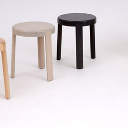 Swedish Baby - The Swedish Baby series of stools is a take on the classic three-legged wooden stool. The side assembly of the legs reveals a delicate connection detail, while the formal language is a play on the tension between the sharp and the soft. Available in table height, counter height and bar height.