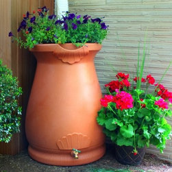Good Ideas Rain Wizard 65 Gallon Rain Barrel Urn - Able to conserve water house flowers and look stylish all at once the Rain Wizard 65 Gallon Rain Barrel Urn is a smart choice for your backyard. It's constructed from thick durable polyethylene resin which holds up to the harshest elements. This barrel won't fade crack or splinter. It has a natural-looking terra cotta finish to make it look right at home in its outdoor setting. A graceful shape and attractive details on the exterior make it an accent piece in addition to something that's working hard for you. This rain barrel has a flat back design to optimize space. It will sit flush against walls giving you greater flexibility on where to place it. It's the only one of its kind. There is also a channel built into the rim to divert overflowing water to the front away from the barrel and your home's foundation. About Good Ideas Inc.Based in Lake City Penn. Good Ideas Inc. was founded in 2001 and has been promoting green living ever since. Many of their innovative products have been featured in magazines newspapers TV shows and news stories. Good Ideas' products focus on sustainability and are developed from practical common-sense ideas generated from consumer needs. Good Ideas' great products include the Rain Wizard Big Blue Rain Saver Compost Wizard and many more. Please note this product does not ship to Pennsylvania.