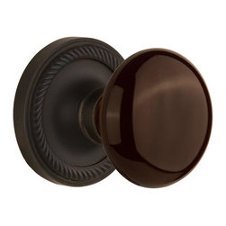 Nostalgic - Nostalgic Mortise-Rope Rose-Brown Porcelain Knob-Oil-Rubbed Bronze (NW-710869) - Blending rich detail and subdued refinement, the Rope Rosette in oil rubbed bronze captures a style that has been a favorite for centuries. Adding our rich, Brown Porcelain knob only serves to compliment the warm, earthen hues in your home. All Nostalgic Warehouse knobs are mounted on a solid (not plated) forged brass base for durability and beauty.
