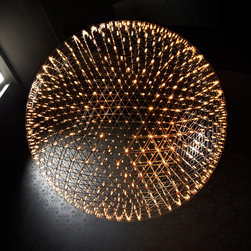 Moooi - Raimond Suspension without Canopy - Raimond non-dimmable suspension in stainless steel has intricate spheres transporting LED terminals to create an atmospheric ambiance. Non-dimmable power supply included in power box. Available in three sizes. Small: Includes 492 LEDs totaling 46 watts, 1684 lumens. 50 inch diameter. Medium: Includes 812 LEDs totaling 70 watts, 2779 lumens. 64.2 inch diameter. Large: 1212 LEDs totaling 100 watts, 4148 lumens. 78.3 inch diameter. 2700K color temperature. Includes field adjustable suspension cable with 31.5 inch minimum to 314 inch maximum. Fixture does not include canopy. Does not fit through standard door frame.