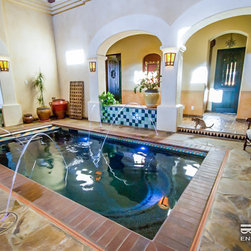 Fastlane by Endless Pools - The arched doorways, multicolored tile, and rustic appointments give this indoor pool room a distinctly Mexican air.