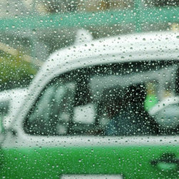 New Images - A shot of a vintage car on a rainy day.