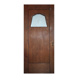 """Antique Doors - A salvaged 36"""" Art Deco entry door with a fabulous geometric  pane of beveled and hand cut glass, circa 1930. This door was salvaged from a home in Charlotte, NC and features a beveled central pane featuring a hand-cut starburst design. The door has been stained brown on both sides; some pieces of the veneer outline are missing, as pictured. The door has various scratches, chips, and dings typical of an old door, as pictured. The exterior door measures 36"""" wide, 80"""" tall, and 1-3/4"""" thick."""
