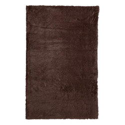 Home Decorators Collection - Faux Sheepskin Area Rug - Enjoy the luxury and softness of a real sheepskin rug without the expensive price tag. Our faux sheepskin area rugs look and feel just like the real thing, with a fur-like texture and suede-like backing. Our synthetic rugs are durably and expertly crafted.  It is normal for Faux Sheepskin rugs to shed fibers for up to three months, depending on care and usage. Regular vacuuming will help pick up these fibers and keep the rug looking fresh and clean.Tightly Wilton-woven of Derclon to endure heavy usage. Perfect for high-traffic areas like the bathroom or living room.