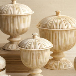 Set of 3 Bone Marquetry Pedestal Covered Boxes - Marquetry is the art of cutting thin pieces of wood, bone, shell, or metal into intricately beautiful shapes. Reminiscent of intriguing ivory, the ever elegant Marquetry Pedestal Jars are lovely in a grouping or placed sporadically through your design space. Capture the essence of traditional decor with pieces that are a lovely homage to centuries past.