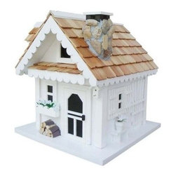 Home Bazaar Tranquility Birdhouse - Who knew that a birdhouse could be so transcendent? The Home Bazaar Tranquility Birdhouse is a beautifully designed model straight from the Cottage Charmer Series. It features roof line scrollwork, a stone chimney and chimney cap, side bench, bay window, storm shutters, trellis, and more adorable details to give it a rich personality that will invite your favorite bird to come build a nest. Your new birdhouse also comes with a mounting plate for easy installation on a wooden 4x4 and a steel cable for hanging from a tree limb or your back patio.About Home BazaarCombining their love of birds and nature with their technical and design abilities, the people of Home Bazaar set out to create the world's most spectacular line of birdhouses and birdfeeders in 1999. They've even created a line of architectural birdhouses, feeders, pedestals, and garden accessories. These items are created using only the finest materials and with painstaking attention to detail. Each product is manufactured for functional use and to be enjoyed for years. Distinctive bird houses and feeders can be matched with accommodating pedestals and these pieces can be placed in the backyard or the garden. Cottage designs and pieces with Victorian scrollwork often end up on covered porches or inside the home as decorative accents.