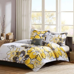 Mizone Mackenzie Quilt Set - Add a pop of color to your dorm room with the Mizone Mackenzie Quilt Set. Bright yellow and grey come together in an oversized floral pattern you'll love. This 100% polyester quilt set will surround you in comfort and is conveniently machine-washable. It's offered in a variety of sizes. Your set comes with the quilt, either one or two pillow shams, and a decorative pillow.Quilt Dimensions:Twin/twin XL: 68 x 90 in.Full/queen: 86 x 90 in.