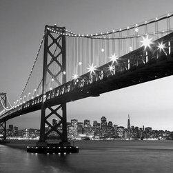 San Francisco Skyline  Wall Mural - With the Golden Gate Bridge in the foreground the San Francisco skyline is a famous and beautiful sight to behold. This black and white mural brings a stunning photographic view to your wall of the city at night with twinkling lights reflecting off of the bay.