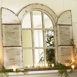 "Arched Door Mirror - Inspired by a vintage window frame, this piece is distressed and textured by hand for a timeworn look. 38"" wide x 47.25"" high x 4"" thick Crafted of fir with a distressed painted finish. Shutters open and close. Internet only."