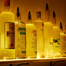 Wall Mounted Shelf- Liquor Bottle - Glass - Bar Display - LED Lighted Wall Mounted Shelf- Liquor Bottle - Glass - Bar Display by Armana Production. Illuminations are situated within of the shelves and to be found to draw attention to objects placed on them.