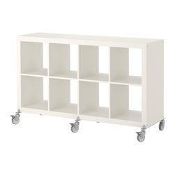 Expedit Shelving Unit on Casters, White - I had to add casters to my Expedit, but now they come with! This is a staple and has been for some time in so many different spaces.