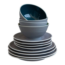 Robert Siegel Studio - Standard Tableware - This set of handmade, wheel-thrown tableware is anything but standard. Ideal for a wedding registry, color combos change seasonally and editions are limited. The 16-piece dinner set includes four each of dinner and salad plates, bowls and mugs. These special sturdy serving dishes are dishwasher and microwave safe.