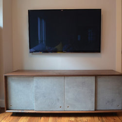 Morris-Titus Media Console - After noticing our infamous Symanski Console on Houzz, we were contacted by a couple to modify the first one into something different.  The client needed other dimensions and wanted to try concrete doors instead of zebrawood.  Who are we to argue...we LOVE concrete!