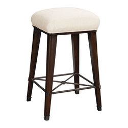Windsor Bar Stool in Dark Walnut and Cream - Enjoy the look of this handsome bar stool, a welcoming spot for friends to perch and an unmistakable contribution to the design of your bar all in one. Its over-upholstered top is secured to a narrow band of solid ash molding by nailhead trim which, with its slim horizon of metallic detail, draws attention to an oiled bronze geometric stretcher which joins the tapering bronze-capped legs. The rounded corners of the square barstool balance its geometry to perfection.