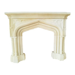 The Gothic Arch Fireplace - This limestone fireplace with Gothic details can be ordered and customized with DeSantana Stone Co. Our team of design professionals is available to answer any questions you may have at: (828) 681-5111.