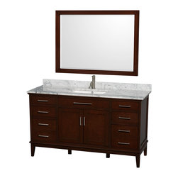 Wyndham Collection - 60 in. Eco-Friendly Single Sink Vanity with Mirror - Includes white Carrera marble countertop with backsplash and undermount square porcelain sink. Faucet not included. Engineered to prevent warping and last a lifetime. 12-stage wood preparation, sanding, painting and hand-finishing process. Highly water-resistant low V.O.C. sealed finish. Transitional styling. Practical floor-standing design. Deep doweled drawers. Fully-extending under-mount soft-close drawer slides. 8 in. widespread 3-hole faucet mount. Concealed soft-close door hinges. 1.25 in. mirror thickness. Plenty of storage and counter space. Pre-drilled for a single faucet hole mount. Metal exterior hardware with brushed chrome finish. Made from solid birch hardwood. Dark chestnut finish. Backsplash: 60 in. W x 0.75 in. D x 3 in. H. Vanity with countertop: 60 in. W x 22 in. D x 35 in. H. Mirror: 44 in. W x 33 in. H (40 lbs.). Countertop: 60 in. W x 22 in. D x 0.75 in. H. Vanity: 60 in. W x 22 in. D x 35 in. H (185 lbs.). Warranty. Care Instructions. Vanity Installation Instructions. Mirror Installation Instructions. Counter Handling InstructionsBring a feeling of texture and depth to your bath with the gorgeous Hatton vanity series. A contemporary classic for the most discerning of customers. The Wyndham Collection is an entirely unique and innovative bath line. Sure to inspire imitators, the original Wyndham Collection sets new standards for design and construction. Compliments any bathroom.
