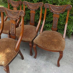 4 Italian Gondolier Chairs - These 4 antique chairs were purchased at the high end interior design store Mitchell Litt, and at that time we were told they were Italian gondolier chairs. Wonderful carving along the back, almost Art Nouveau style with the floral centerpiece and curly leaves or fronds, and the swags are totally great.