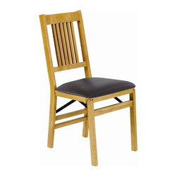 Stakmore - True Mission Folding Chair in Warm Oak Finish - Here's the perfect pair for any seating situation. Each chair is crafted from solid hardwood and features a padded, black vinyl upholstered seat. The backs have narrow slat accents, while a warm oak finish completes the look. Plus, they easily fold for transport or storage. Set of 2. Six vertical slats coming down from horizontal top rail. Shaped curve in top and bottom rails. Steel folding mechanism. Padded black vinyl seat. Folds up to 7.5 in. deep for storage. Made from solid hardwood. No assembly required. 19.25 in. W x 16.5 in. D x 35.5 in. H. Seat height: 18.75 in.