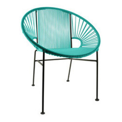 Sun Lover Chair in Turquoise - Sit back and melt into this hoop-shaped modern lounge chair, complete with UV-resistant vinyl cord for breathability and support. Rust-resistant, this chair is weatherproof and easy to clean. Inside or out, it will add a delightful burst of color and circular motion wherever it rests.