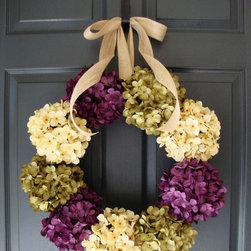 Hydrangea Wreath by HomeHearthGarden - Nothing matches the beauty for a hydrangea wreath. Truly an elegant combination of colors, this wreath design captures a mélange of fresh spring hydrangea colors and endless summer deep tones. A dramatic collection of large artificial pom-pom style hydrangea flowers. A wreath that brings life to your front door or over the hearth, welcoming your guests to your front door.