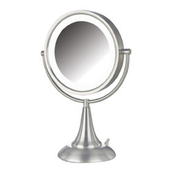 Jerdon HL8510NL 8.5-Inch Tabletop Two-Sided Swivel LED Vanity Mirror with 8x Mag - The Jerdon HL8510NL 8.5-Inch Tabletop Two-Sided Swivel LED Lighted Vanity Mirror is an ideal bathroom and makeup accessory that provides lighting and magnification options to display a clean, bright reflection whenever you need it. This two-sided circular mirror has an 8.5-inch diameter, has a smooth 360-degree swivel rotation and provides 1x and 8x magnification options to make sure every detail of your hair and makeup are in place. The long lasting LED bulbs around the perimeter of the mirror and smooth rotation provide a dynamic point of view. An on/off rotary knob on the base will activate the lighting whenever you need it. The HL8510NL stands 15-inches high, stands upright on countertops, vanities and tables and has an attractive nickel finish that protects against moisture and condensation. The Jerdon HL8510NL 8.5-Inch Tabletop Two-Sided Swivel LED Lighted Vanity Mirror comes with a 1-year limited warranty that protects against any defects due to faulty material or workmanship. The Jerdon Style company has earned a reputation for excellence in the beauty industry with its broad range of quality cosmetic mirrors (including vanity, lighted and wall mount mirrors), hair dryers and other styling appliances. Since 1977, the Jerdon brand has been a leading provider to the finest homes, hotels, resorts, cruise ships and spas worldwide. The company continues to build its position in the market by both improving its existing line with the latest technology, developing new products and expanding its offerings to meet the growing needs of its customers.