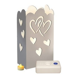 LumaBase Battery Operated Hearts Luminaria Kit - Set of 24 - Commemorate any special occasion in the warmth and glow of the LumaBase Battery Operated Hearts Luminaria Kit - 24 Count.Includes 24 LumaLanterns (die-cut cardboard lined with a flame-resistant bag), 24 battery operated tea light candles with replaceable batteries, 24 LumaBases (reusable, flame-resistant candleholder that anchors the luminaria).About JH SpecialtiesFounded in 1989, JH Specialties originated when the company's entrepreneurs sought to redesign a bulky and messy celebration staple. Today, JH Specialties offers unique decorative Luminarias and accessories for special and seasonal occasions to event planners, neighborhoods, fundraising organizations, and retail stores. Since special occasions shouldn't be hard to plan, JH Specialties offer top-of-the-line products for unique events at a competitive price and a great value. The title of Leader in Luminarias comes from their commitment to quality and customer service.