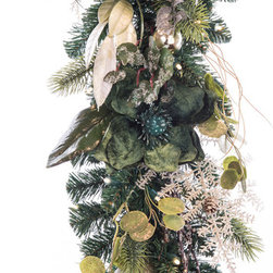Village Lighting - Shimmery Green & Pewter LED Garland - This garland glistens with an arrangement of eucalyptus and magnolia leaves combined with pops of metallic accents set off by shimmering sage green magnolia leaves. Features lifelike PVC and PE tips as well as our exclusive Nun-Chuck battery and Super Mini lighting system.