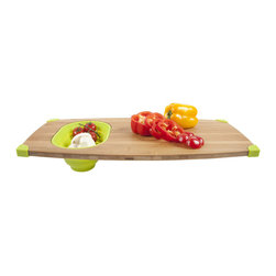 Over the Sink Cutting Board in Lime - Whether you have a small space or just want to free up extra room in your kitchen, use this handy cutting bamboo and silicone board meant to work directly over the sink. A convenient food-safe silicone container nestles within so you can organize your ingredients as you chop and dice. The organic bamboo board comes with fitted corners to perch over your sink and stay in place.