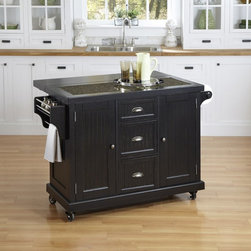 Home Styles - Home Styles Nantucket Distressed Black Kitchen Cart - 5033-95 - Shop for Carts from Hayneedle.com! Provencal charm a luxurious granite countertop and perfectly practical the Home Styles Nantucket Distressed Black Kitchen Cart is just right. A well-made kitchen cart this one is crafted of hardwood solids and engineered wood with a well-loved distressed black finish. Plenty of storage lives in the two cabinet doors that each have an adjustable shelf three drawers built-in spice rack and paper towel holder. You'll love the country fresh bead board panels brushed nickel cup pulls and smooth rolling casters (two even lock). About Home StylesHome Styles is a manufacturer and distributor of RTA (ready to assemble) furniture perfectly suited to today's lifestyles. Blending attractive design with modern functionality their furniture collections span many styles from timeless traditional to cutting-edge contemporary. The great difference between Home Styles and many other RTA furniture manufacturers is that Home Styles pieces feature hardwood construction and quality hardware that stand up to years of use. When shopping for convenient durable items for the home look to Home Styles. You'll appreciate the value.