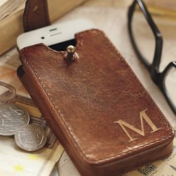 """Saddle Leather iPhone(R) Case - More beautiful than the average iPhone case - and more protective - ours cradles yours in stylish, soft saddle leather. 2.5"""" wide x 1"""" deep x 4.5"""" high Crafted of finely grained leather with a lightly distressed cognac coloring. Case offers handsome, durable storage. Distressed leather over MDF; dark brown faux suede interior and brass hardware. Monogramming is available at an additional charge. Monogram will be centered on the lower-right-hand corner on the front of the case."""