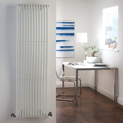 Hudson Reed - Modern White Vertical Designer Wave Radiator Heater 63 x 18 & Valves - With an impressive heat output of 1,120 Watts (3,819 BTUs), this designer wave radiator, in a fashionable White finish, is eye-catching, stylish and highly efficient, ensuring that your room is heated quickly.While the smooth, curving lines of this vertical designer radiator bring a touch of elegance to any living space, the white radiator is highly functional, connecting directly into your domestic central heating system via Hudson Reed radiator valves included.White Designer Wave Radiator 63 x 18 Details  Dimensions: (H x W x D) 63 (1600mm) x 18 (460mm) x 4.3 (110mm) Output: 1,120 Watts (3,819 BTUs) Pipe centres with valves: 21.65 (550mm) Number of columns: 12 Designed to be plumbed into your central heating system Suitable for bathroom, cloakroom, kitchen etc. Please note: Angled radiator valves included  Buy now, to transform your living space, at an affordable price.5 year guarantee Please Note: Our radiators are designed for forced circulation closed loop systems only. They are not compatible with open loop, gravity hot water or steam systems.
