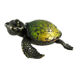 Cute Mosaic Green Glass Sea Turtle Accent Lamp Crush - This beautiful green stained glass sea turtle shaped lamp adds the perfect accent to desks or nightstands of turtle lovers. Measuring 3 1/6 inches tall, 8 inches long and 6 inches wide, the lamp features an antiqued bronze finished resin base of the turtle`s head, legs and tail, with the shell made of tiny bits of green glass. He looks a bit like Crush from the film Finding Nemo. The lamp is brand new, never used or displayed. It uses one nightlight style bulb (included). It makes a great gift idea. We have a very limited supply of these, so don`t delay. Get yours now!