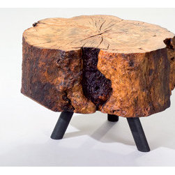 Albero Side Table - Each one of these stools is unique, as they are made from fallen trees. They perch upon short sturdy legs, which further emphasize their heft. This is simply charming rustic chic, that fits right into an uber-contemporary room.