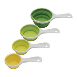 Chef'n SleekStor Pinch & Pour Measuring Cups - These measuring cups work best in a pinch.  When you pinch the sides  that is  to reveal a convenient pour spout.  They are space savers  too; the heat and stain-resistant silicone cups expand for use and collapse for convenient storage.Product Features                               Pinch frames to create pour-spout          Includes 1  1/2  1/3  and 1/4  cups          Collapsible  space-saving design          Storage ring included          Not for use in microwave          Top-rack dishwasher safe