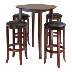 Winsome Wood - Winsome Wood Fiona 5 Piece Round High/Pub Table Set w/ PVC Stools - 5 Piece Round High/Pub Table Set w/ PVC Stools belongs to Fiona Collection by Winsome Wood Refined details and casual elegance best describe this pub-style table with slightly flared legs. With a deep, rich walnut finish, the round table is an ideal size for a cozy dinner, working on your laptop or playing a game of cards. The 5-piece set comes with four, round swivel barstools. The barstools have a heavy-duty ball bearing swivel and a black faux-leather PVC upholstered cushion. This versatile set will look stunning in your kitchen, breakfast area or family room. Pub Table (1), Stool (4)