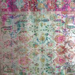 New Silk Rugs - Traditional patterns with a contemporary color palette.
