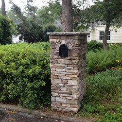 Stone mailbox - Hubert Burns This is the after picture of our mailbox system. This mailbox was installed with two men in less than one hour.  This is man made stone. However there are other styles that will be available  One will be coming out in real stone.  My Outdoor Rooms has a full line of prefab masonry products and wood products. Prefab outdoor kitchens pavilions and pergolas are also part of their product line.