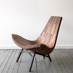 Water Tower Lounge Chair - This lounge chair is made of recycled timbers from a New York City water tower. How cool is that? I love how furniture designers can turn old things into such beautiful work. My dad once made me a dining table out of my Grandma's old milk shed, and I love it.