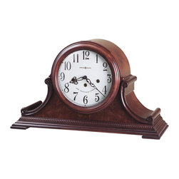 Howard Miller - Howard Miller - Palmer Mantel Clock - Enhance your cabinet, decorative stools, or mantel space with this exceptionally crafted and designed Carved Scroll Commemorative Clock featuring Windsor cherry on first class hardwoods, gorgeous black Arabic numerals and serpentine hour and minute hands among other rich accents. * This 79th Anniversary Edition tambour style mantel clock is rich in details. . A beaded molding surrounds the base, accenting the carved side scrolls and olive ash burl veneered front panel.. Beneath a convex glass crystal, the lambswool dial offers black Arabic numerals, black serpentine hour and minute hands, and a special 78th Anniversary inscription (inscribed through 2004) . Key-wound, Westminster chime movement with chime silence option and durable bronze bushings. . Finished in Windsor Cherry on select hardwoods and veneers. . 11-1/4in (29 cm) H x 19in (48 cm) W x 6-3/4in (17 cm) D